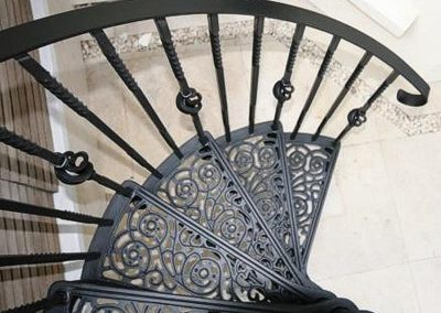 Filigree pattern on treads of cast iron spiral stair