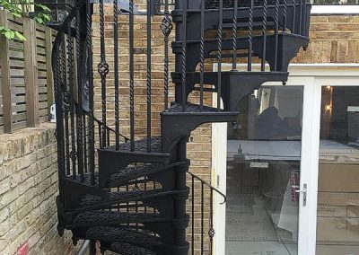 External Cast iron staircase using basket and double twist balusters