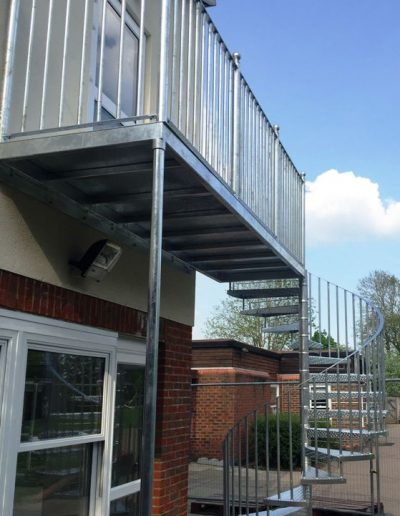 Galvanised fire escape with landing compressed