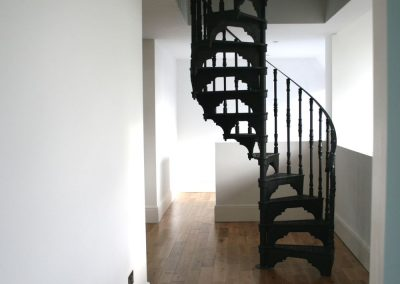 Cast iron stair in modern home to loft