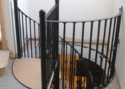Traditional stair with round hole to loft